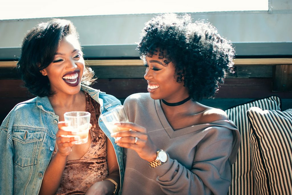Two friends sharing a drink at happy hour